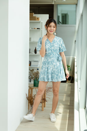 *BACKORDER* Ambrose Floral Faux Wrap Romper In Light Blue