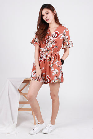 *TSA Label* Nadine Sleeved Floral Romper In Rust