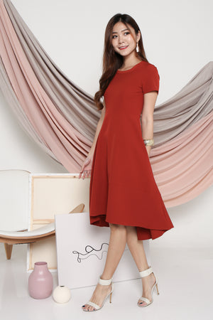 Lucinda Curve Hem Dress In Burnt Orange