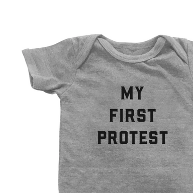 Love Bubby First Protest Onesie on Design Life Kids