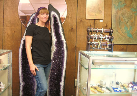 owner Stacie Anthony with pair of Amethyst cathedrals from Brazil