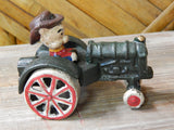 Cast Iron Figurine - Porky Pig on Farm Tractor