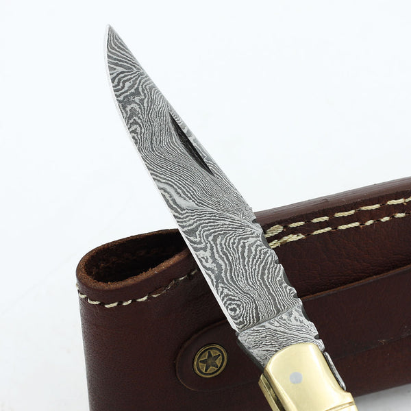 DEANA Handmade Damascus steel folding knife with horn handle and brass bolsters