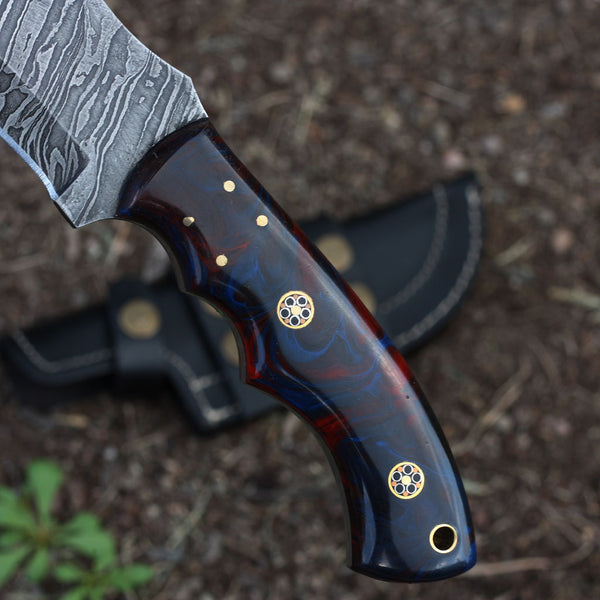 SELMA Handmade Damascus steel tracker knife with colored bone handle.
