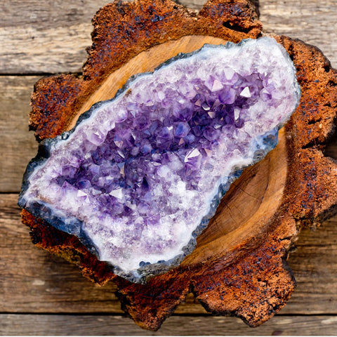 amethyst druzy geode on a wooden plate