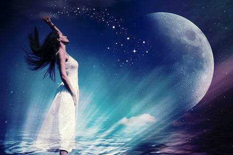 girl facing the moon doing moon magic
