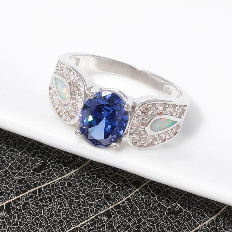 Blue Topaz Ring with White Fire Opal