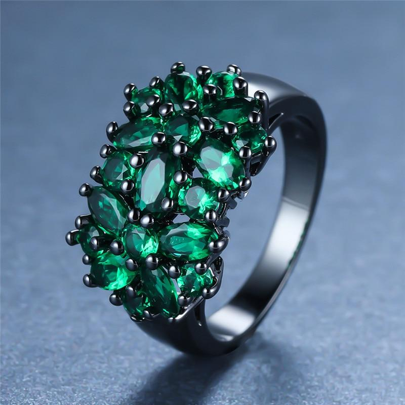 Emerald Dyad Flower Black Gold Ring