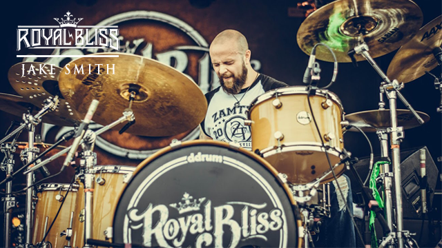 A close up live concert image of Jake Smith Drummer for Royal Bliss performing live