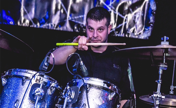 Drummer posing with drums