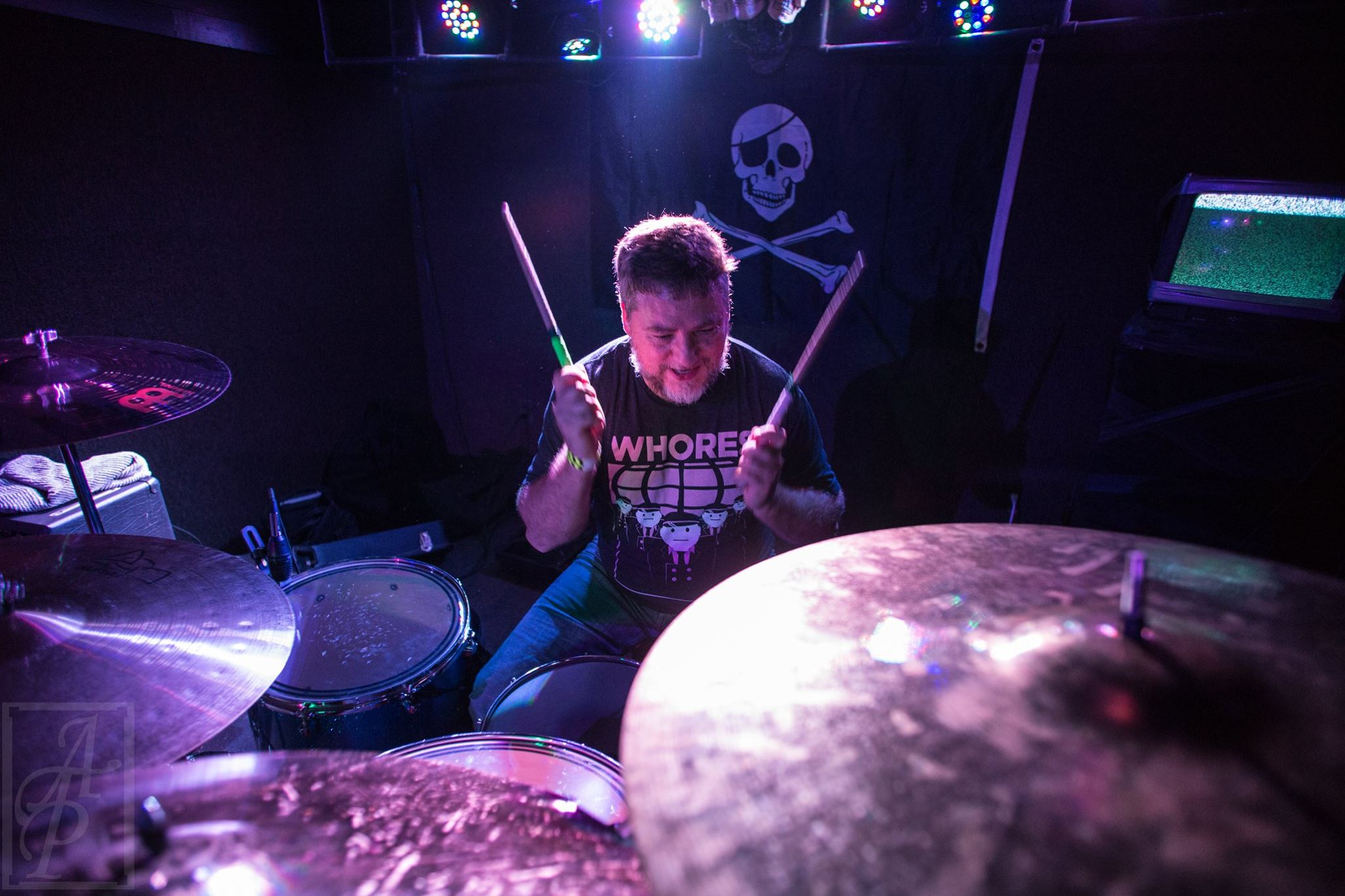 Drummer Todd Karinen poses with Scorpion Percussion drumsticks behind his drumkit