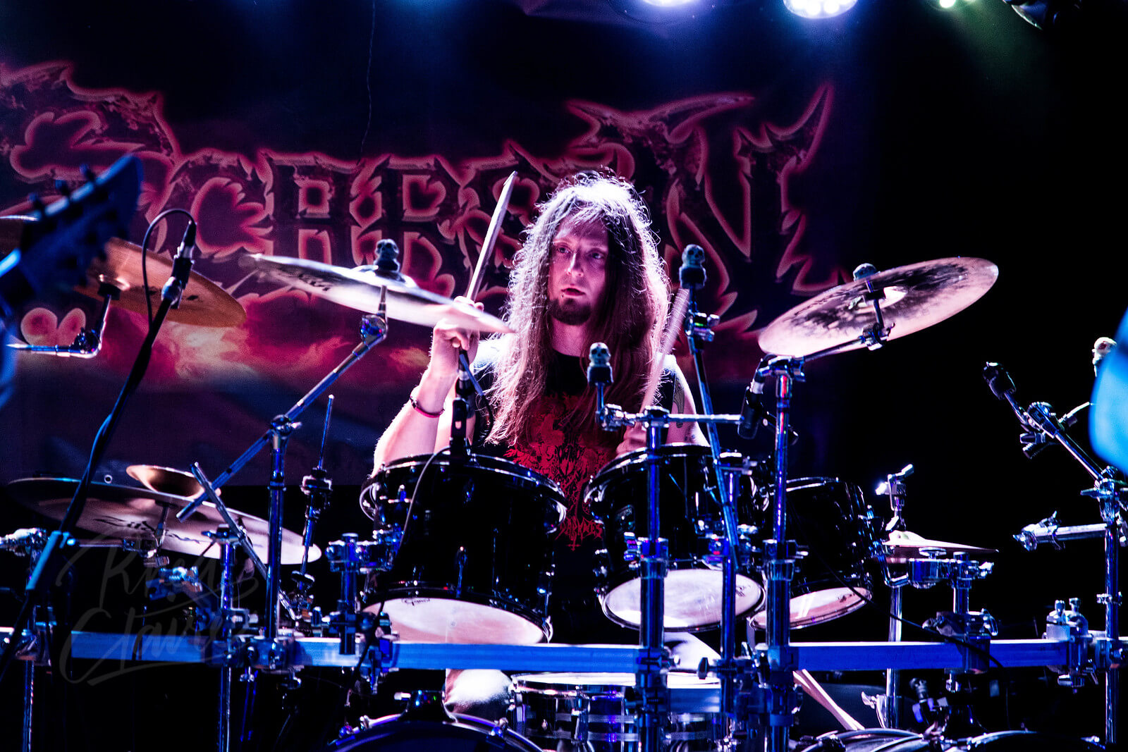 Drummer Jason Caruana poses with Scorpion Percussion drumsticks behind his drumkit