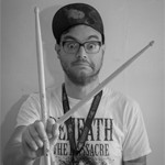 Black and White Picture of drummer posing with drumsticks