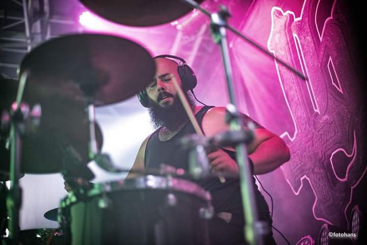 Drummer Angel Cotte poses with Scorpion Percussion drumsticks behind his drumkit