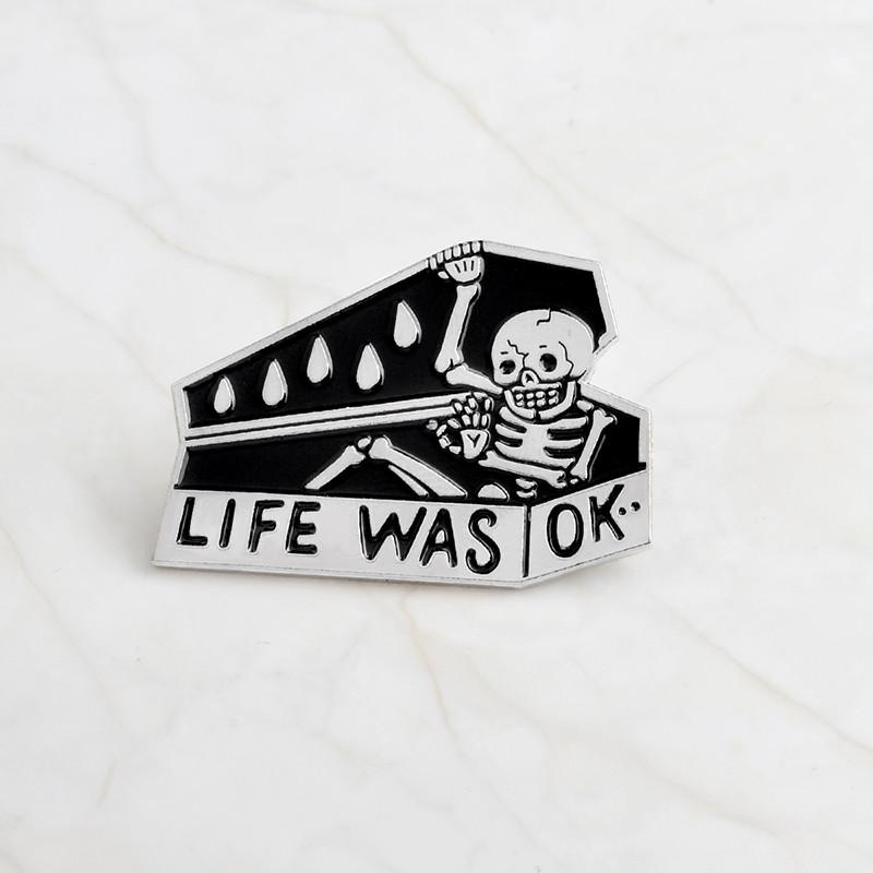 """LIFE WAS OK"" skull coffin enamel pins"
