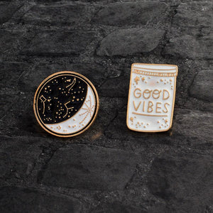 Good Vibes and Moon enamel pins