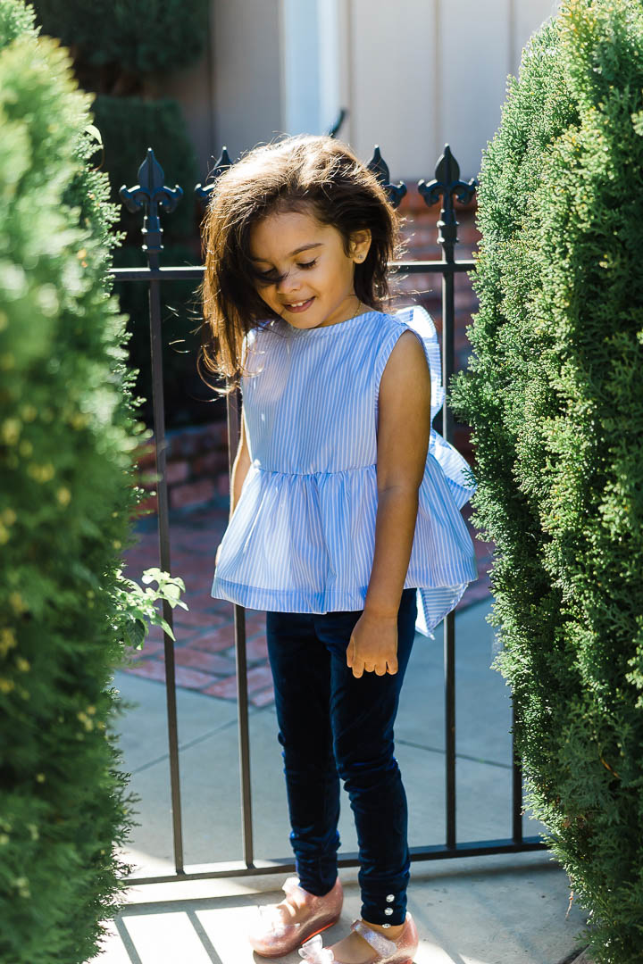 Blue and white striped top worn by toddler girl