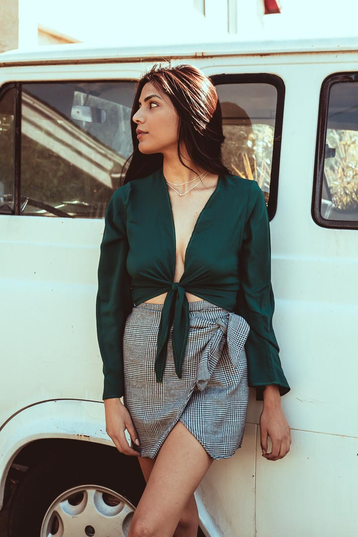 Emerald Tie Front Top with plaid skirt worn by woman next to VW bus