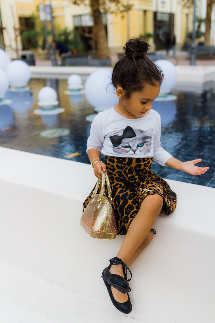 Girl wearing leopard skirt and cat shirt