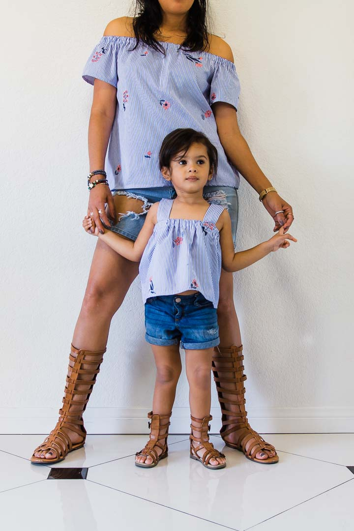 mommy and daughter wearing blue striped set with jean shorts