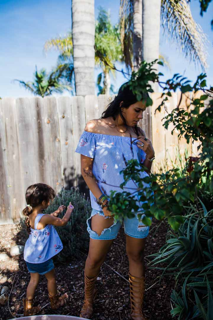 mom & daughter wearing a blue striped top set with flowers