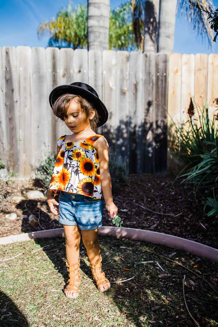 toddler girl wearing sunflower blouse and jeans