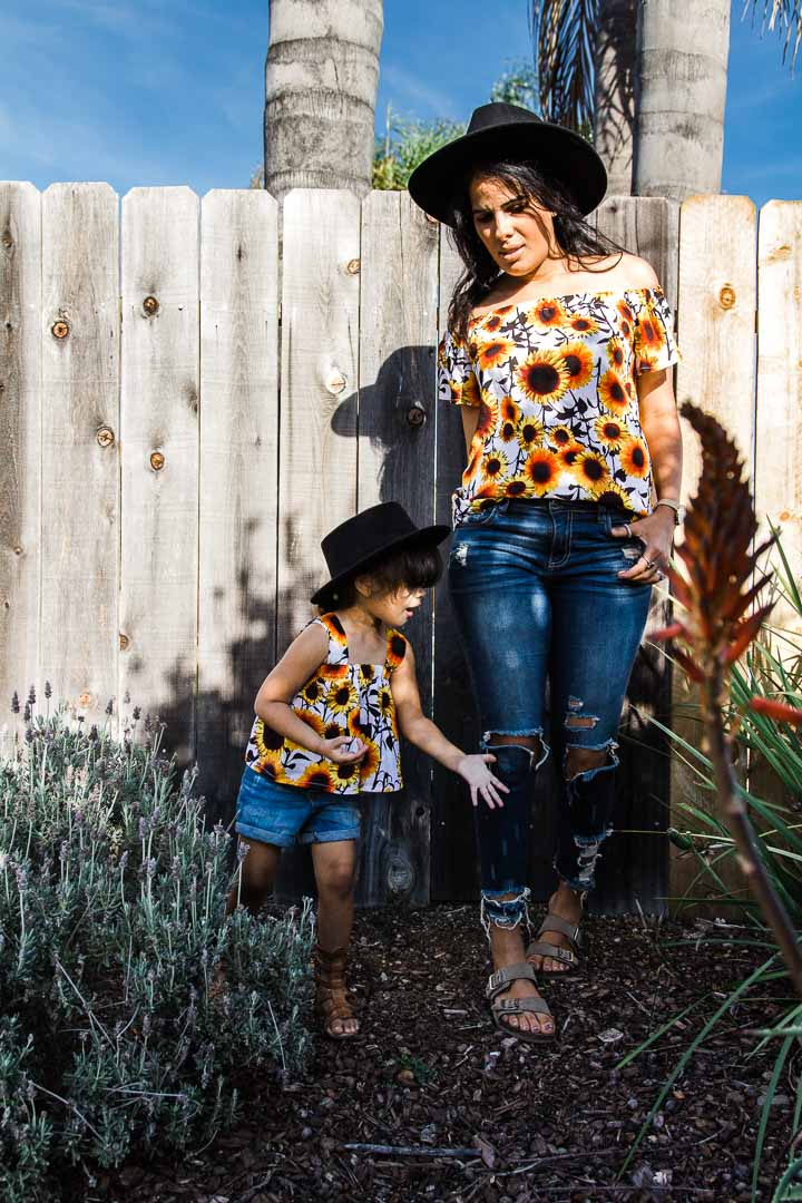 matching mom and me tops, sunflower pattern and jeans