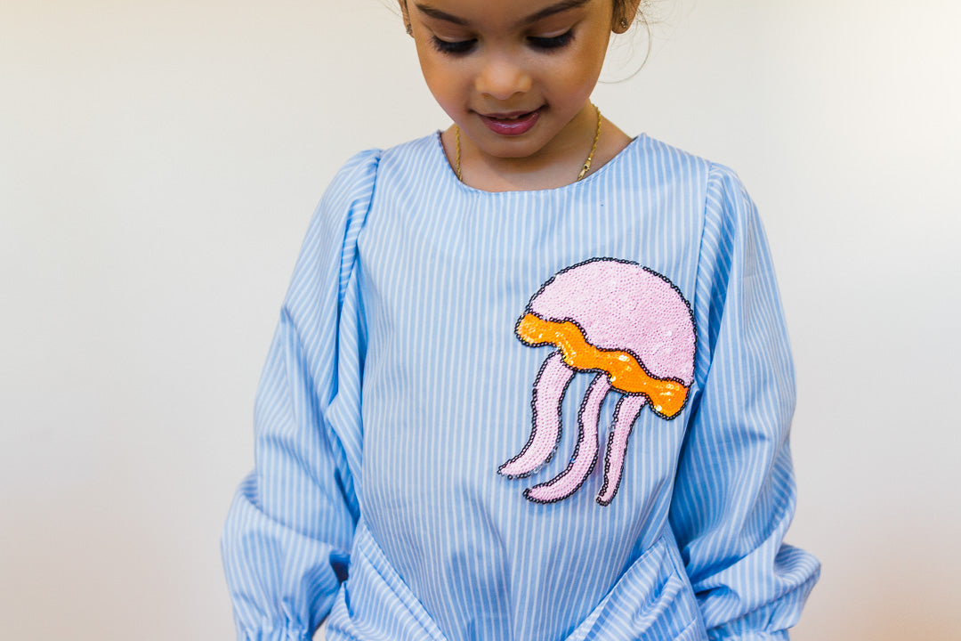 Jellyfish patch dress worn by toddler girl
