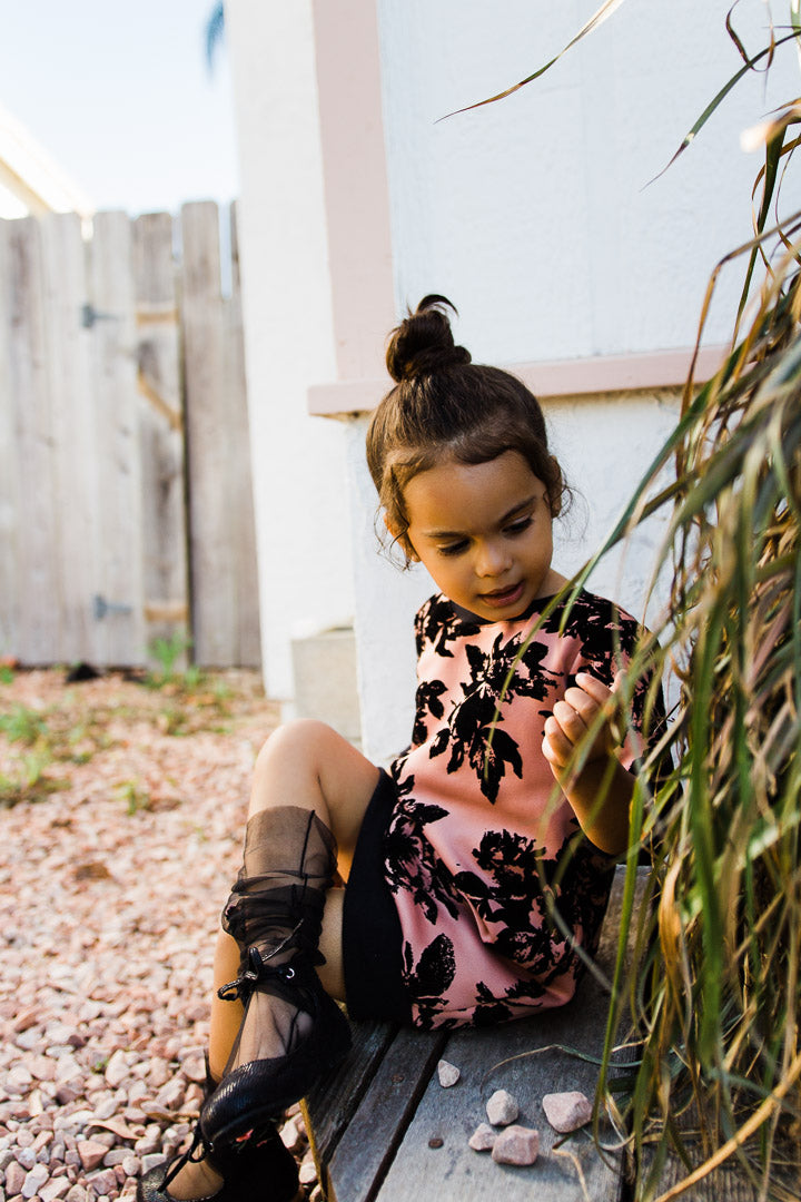 Little girl sweater dress with black flowers
