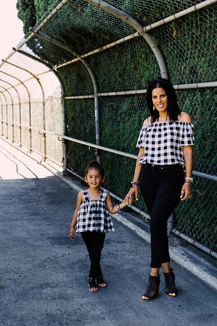 Matching black and white tops mother and daughter outfits