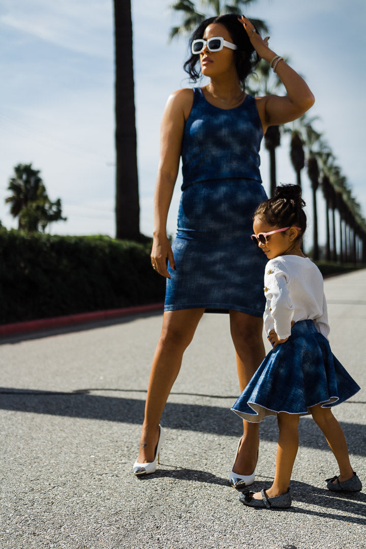 Mom and daughter modeling jean dress and skirt