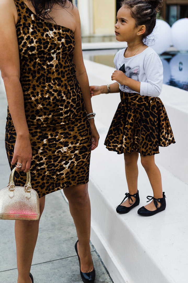 Mom and daughter wearing matching leopard skirt and dress
