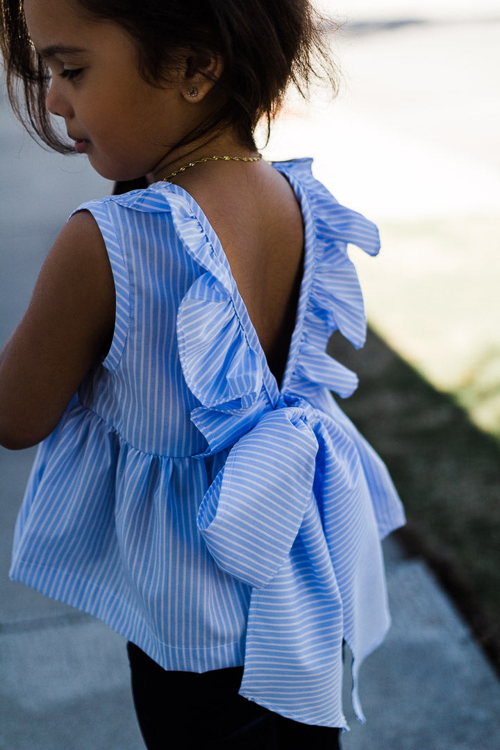 Sleeveless ruffle top worn by toddler girl