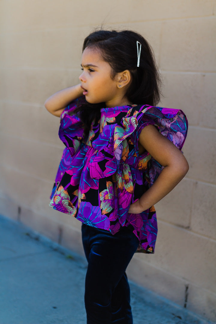 floral blouse worn by girl