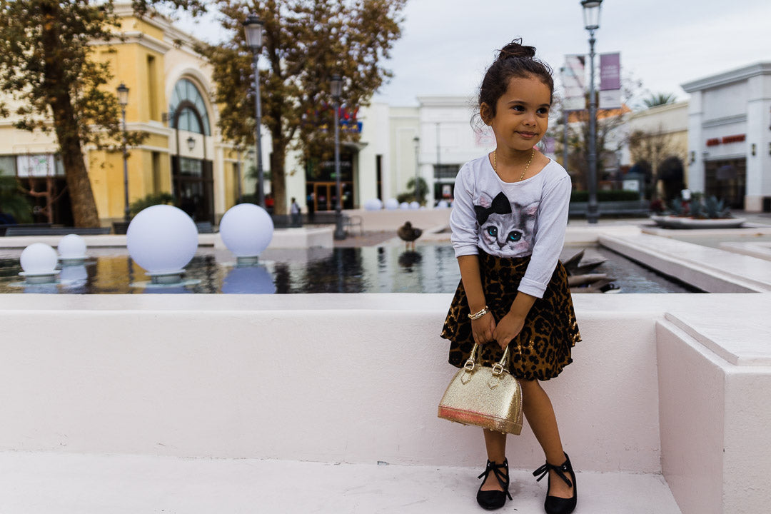 girl next to fountain wearing leopard circle skirt