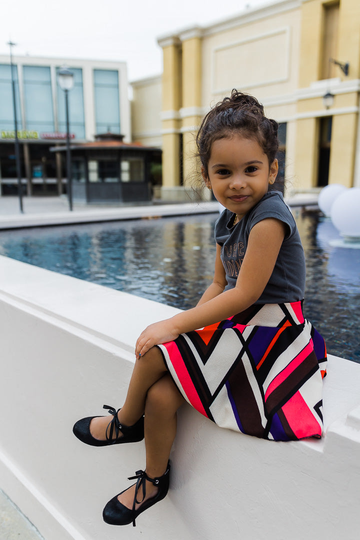 girl wearing colorful chevron skirt