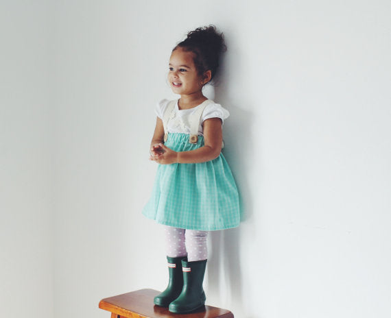 girl with green boots and a vintage suspender skirt