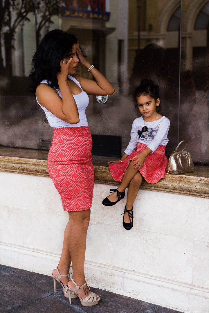 mom and daughter wearing coral mesh skirts