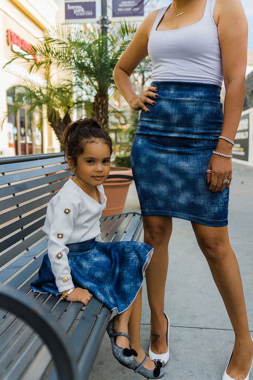 mom and daughter wearing matching blue skirt