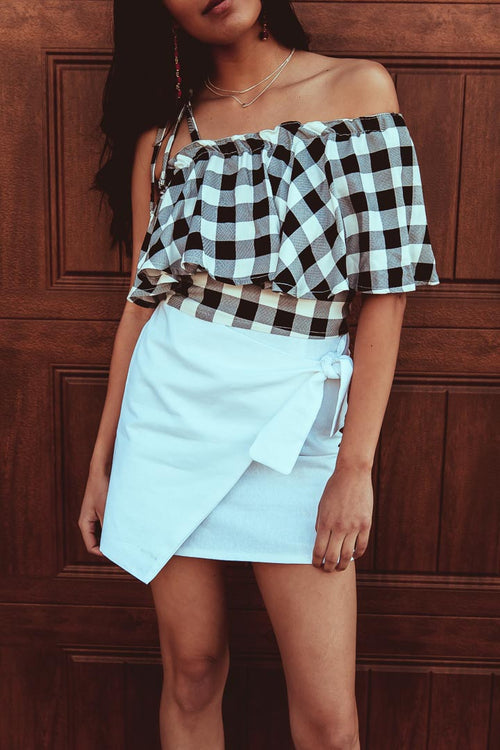white linen mini skirt with checker top worn by woman
