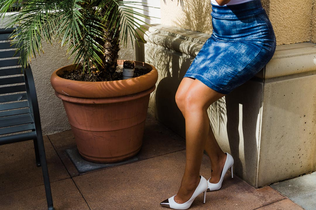 woman wearing blue skirt, sitting down
