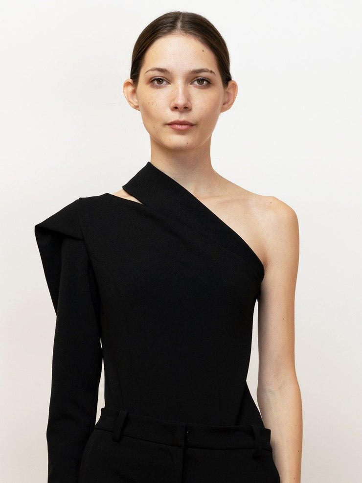 Edessa one shoulder bodysuit with draped sleeve in stretch crepe.
