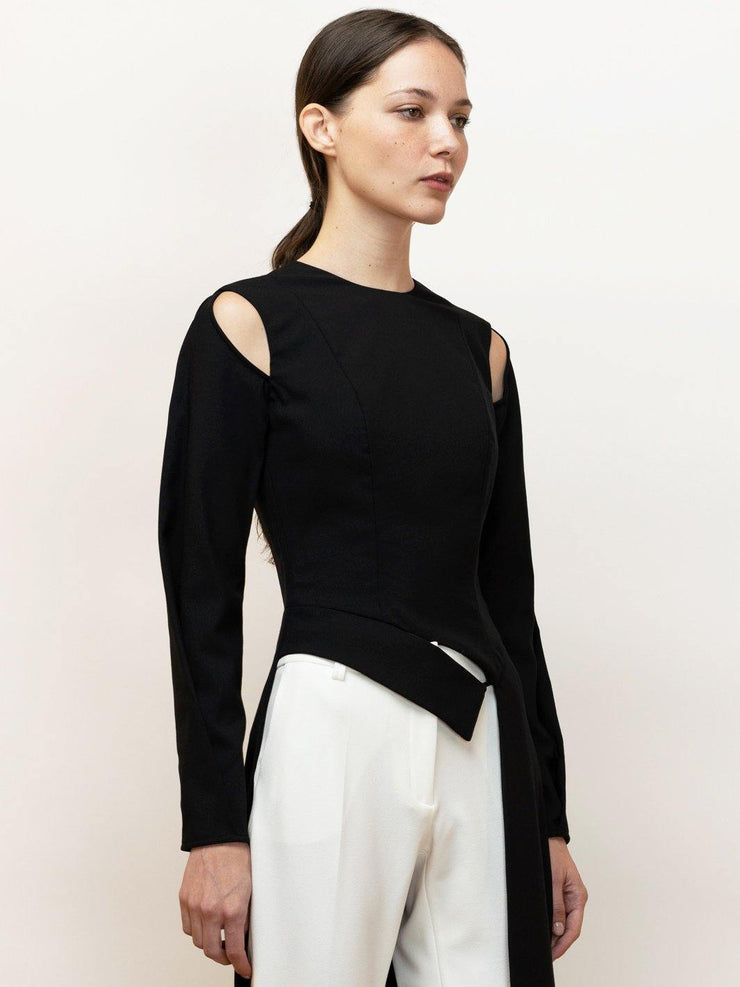Hera long black top with draped sleeves and cutouts.