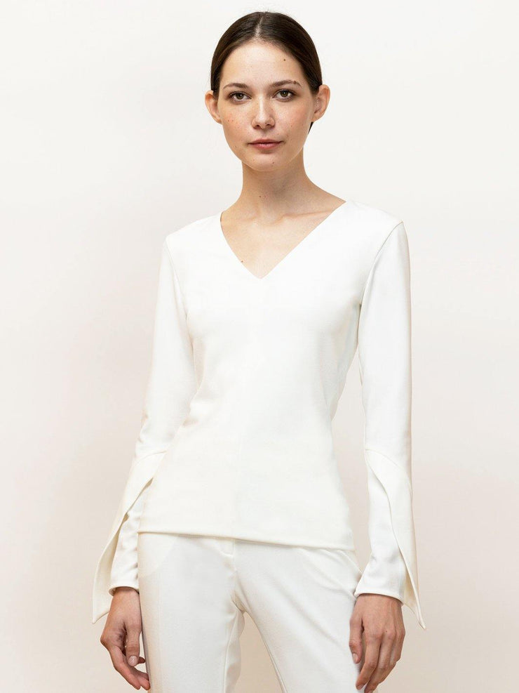 Nea - Stretch Long Sleeve Top With V-neck and Draped Sleeve - Front Closeup