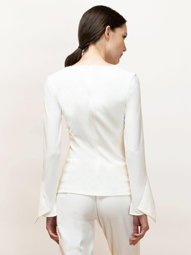 Nea stretch long sleeve top with V neck and draped sleeve.