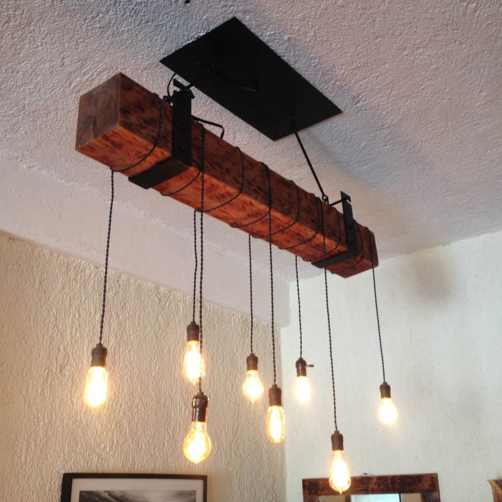Reclaimed wood beam chandelier with iron brackets unique wood