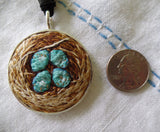 lovingly hand embroidered pendant