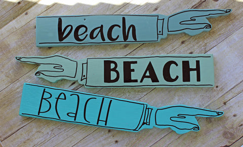 beach wooden pointy sign