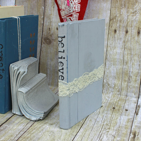 believe repurposed book art