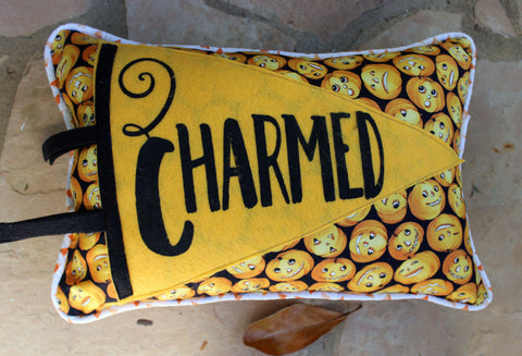 vintage-style pennant pillow - we're Charmed in yellow!